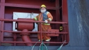 A Newfoundland longshoreman named Clifford stands on the the deck of the Bruarfoss as it prepares to move containers in Argentia, Newfoundland.