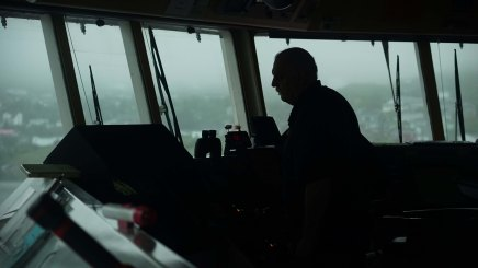Captain Gestur Helgason guides the Bruarfoss into St. Anthony, Newfoundland.