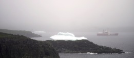 An iceberg floats outside the entrance to the harbor at St. Anthony, Newfoundland.