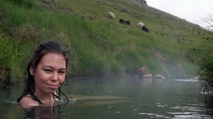 Ihila relaxes in a stream heated by hot springs near the town of Hveragerði in the Reykjadalur Valley. We traveled here from Reykjavik on two pubic buses.