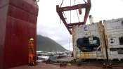 he crew of the Bruarfoss loads a refrigerated container packed with frozen fish. The Bruarfoss is in Isafjordur, a small port on the northwest coast of Iceland.