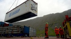 The crew of the Bruarfoss loads a refrigerated container packed with frozen fish. The Bruarfoss is in Isafjordur, a small port on the northwest coast of Iceland.