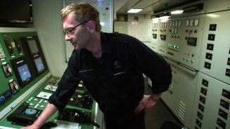 Hjortur Gudmundson, chief engineer on the Bruarfoss, monitors the performance of the engine.